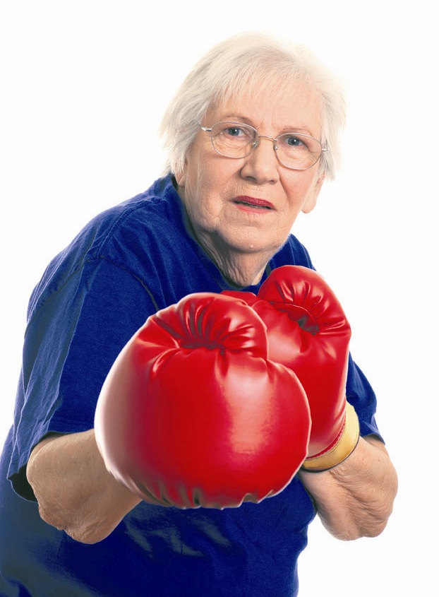 Isolated Senior woman boxing on a white background